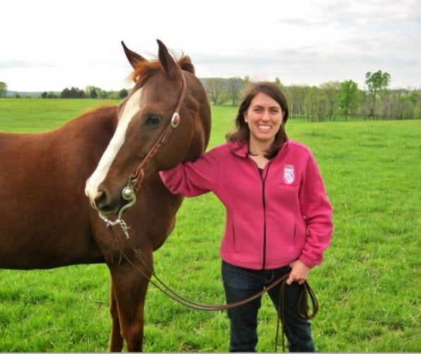 Team member Shanna with her brown and white horse
